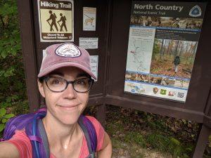 woman near hiking trail